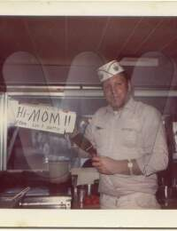 Leo Johnson working in his carnival food stand